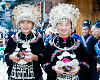 Miao women welcoming guests